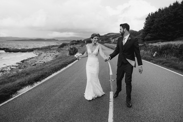 coastal wedding walking couple on road