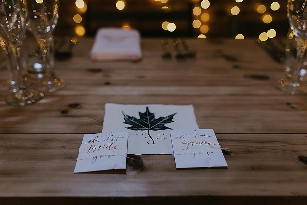 Handmade gold script place names wedding