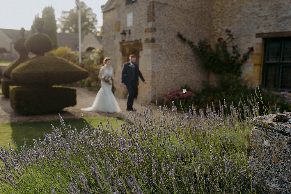out of focus image of bride and groom walking