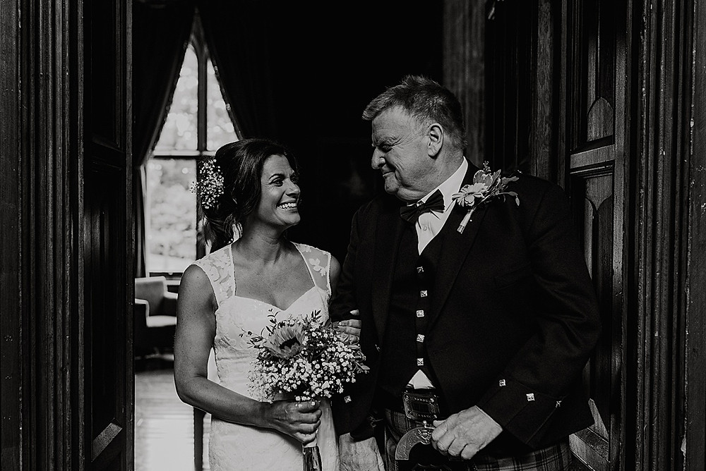 father and bride before ceremony