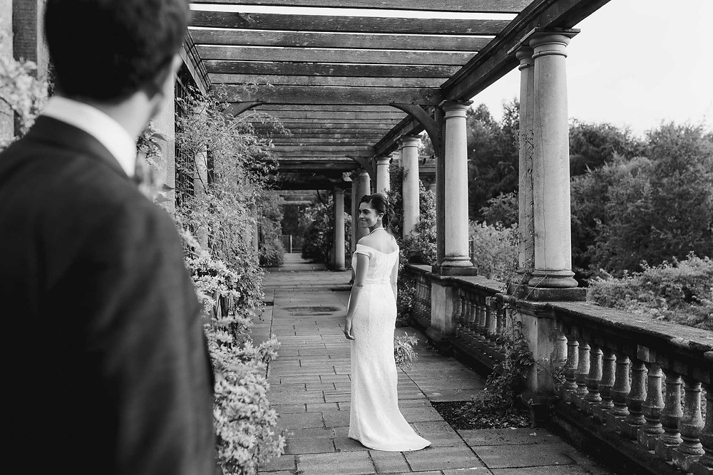 photo of groom with bride walking away