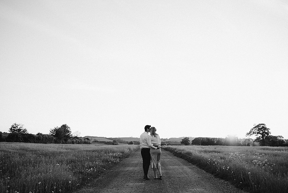 black and white photo of couple on road
