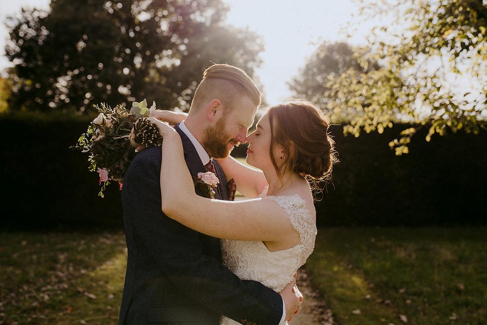 wedding couple at sulgrave manor sunset