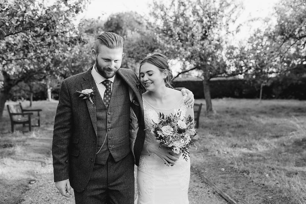 black and white documentary photo of wedding couple