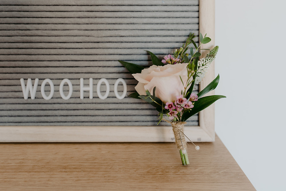 rose button hole and woohoo sign