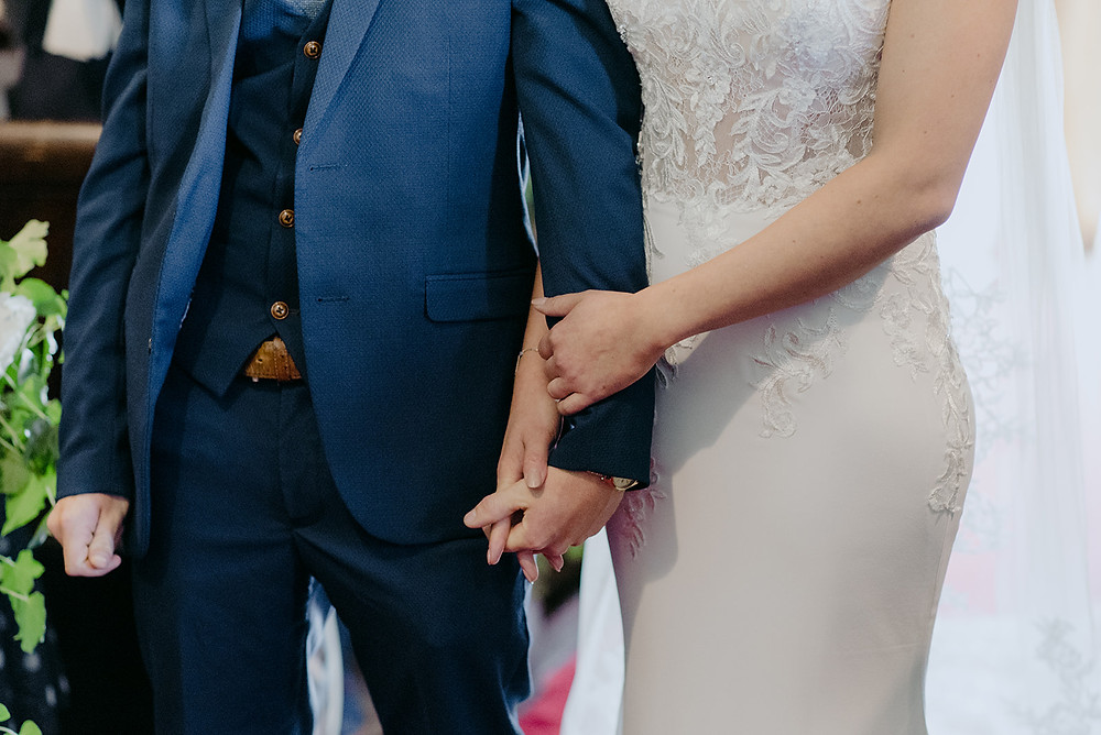 close up photo of bride and groom hands