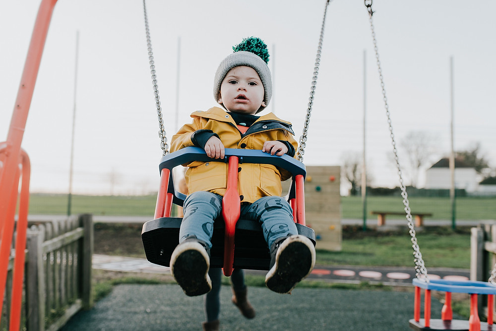 swing in playground family photoshoot