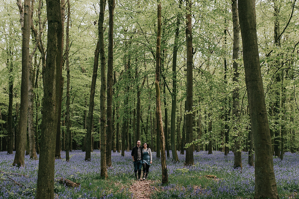 wide shot of couple in bluebell woods