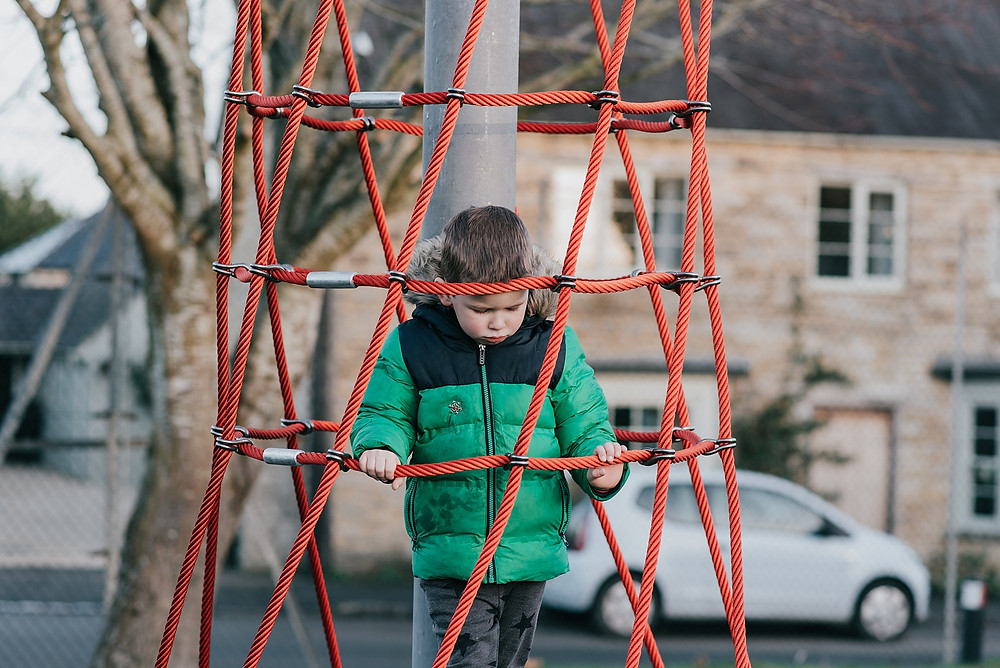 boy in the playground waiting