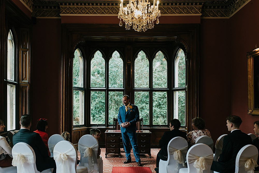 groom waiting for bride gothic mansion