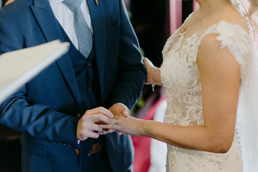 close up of wedding ring exchange