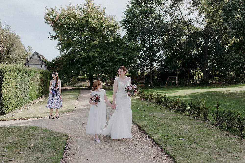 bride and flower girl walking sulgrave manor
