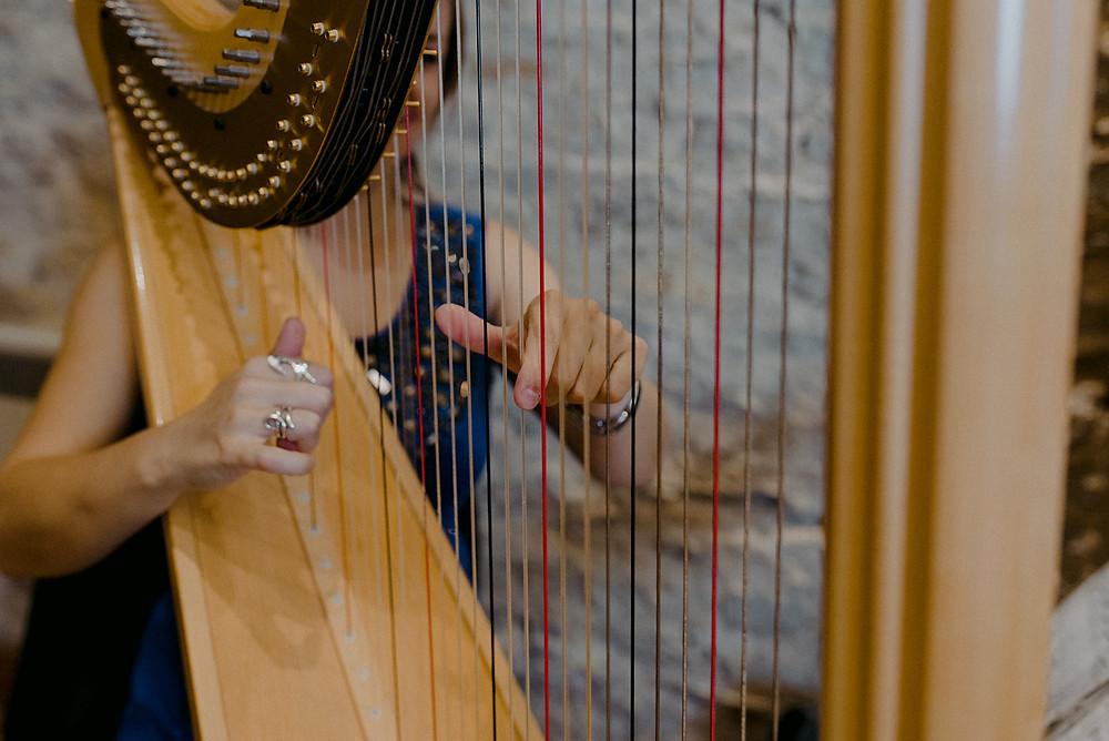 close up of harp player at wedding