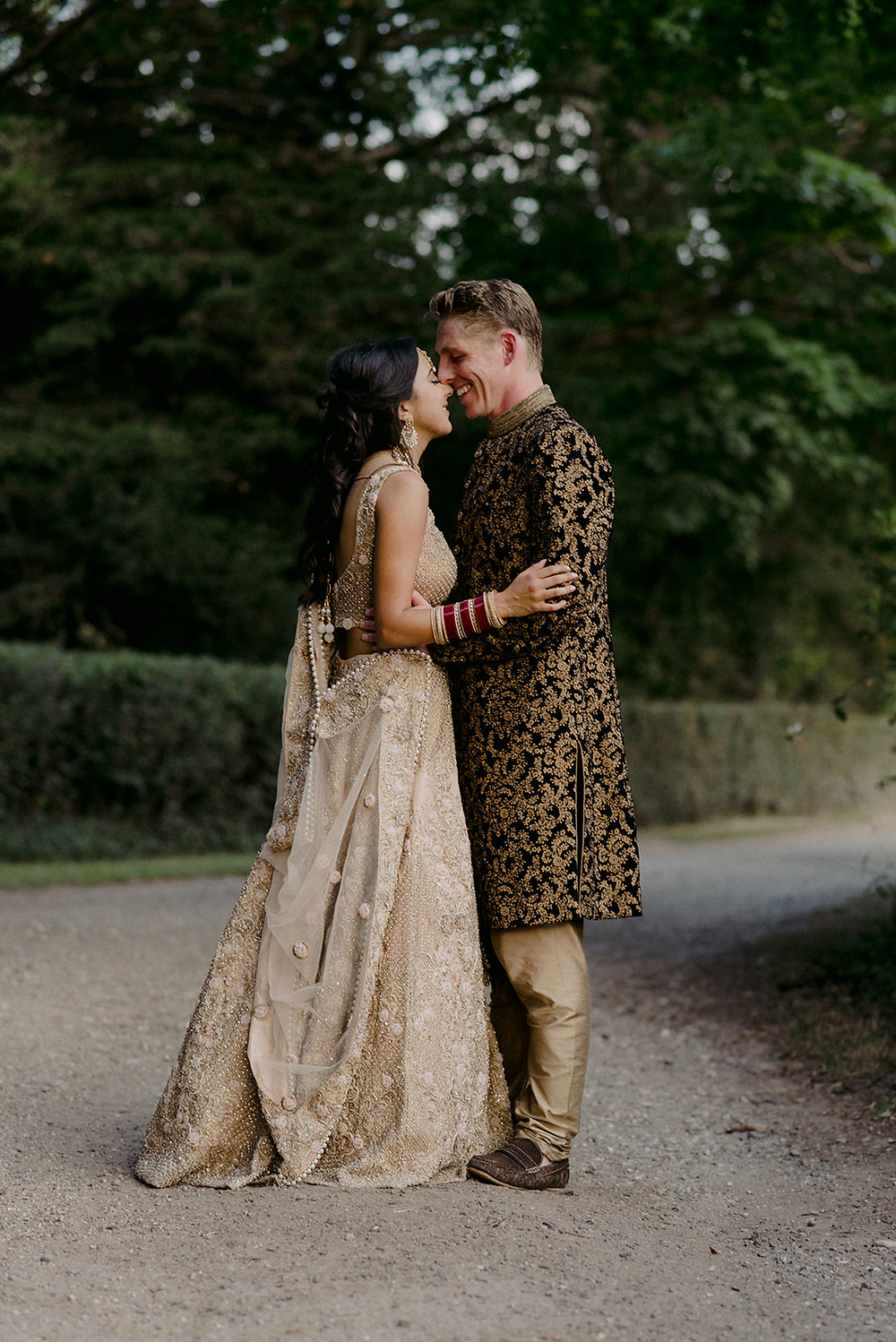 bride in gold and beige indian wedding dress