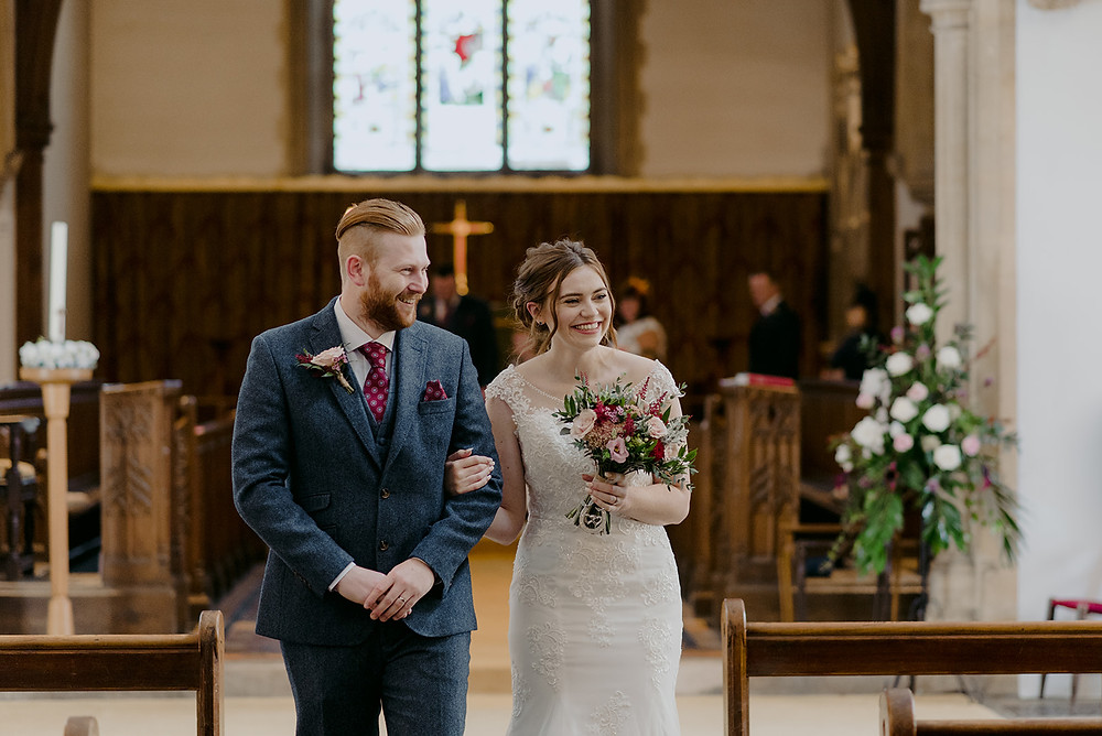 wedding couple exit st peters church brackley