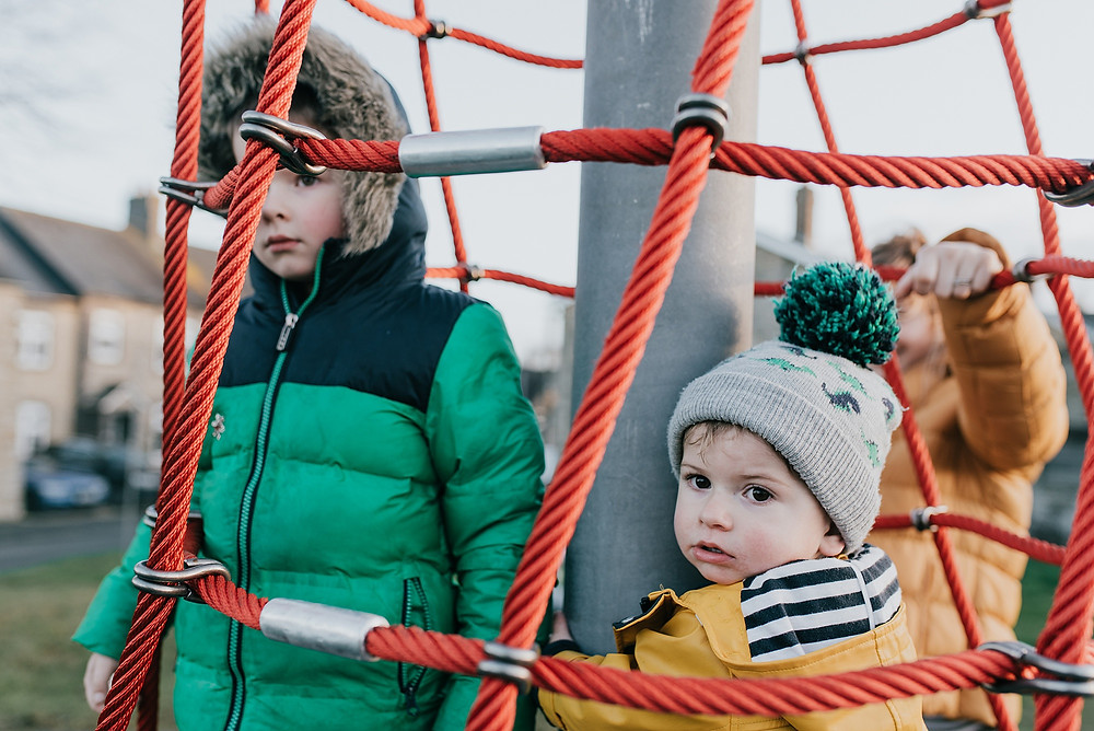colourful outfits on climbing frame family