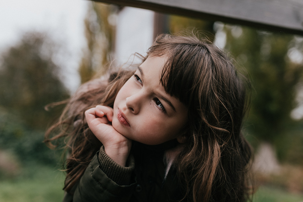 relaxed family photography outdoors girl thinking
