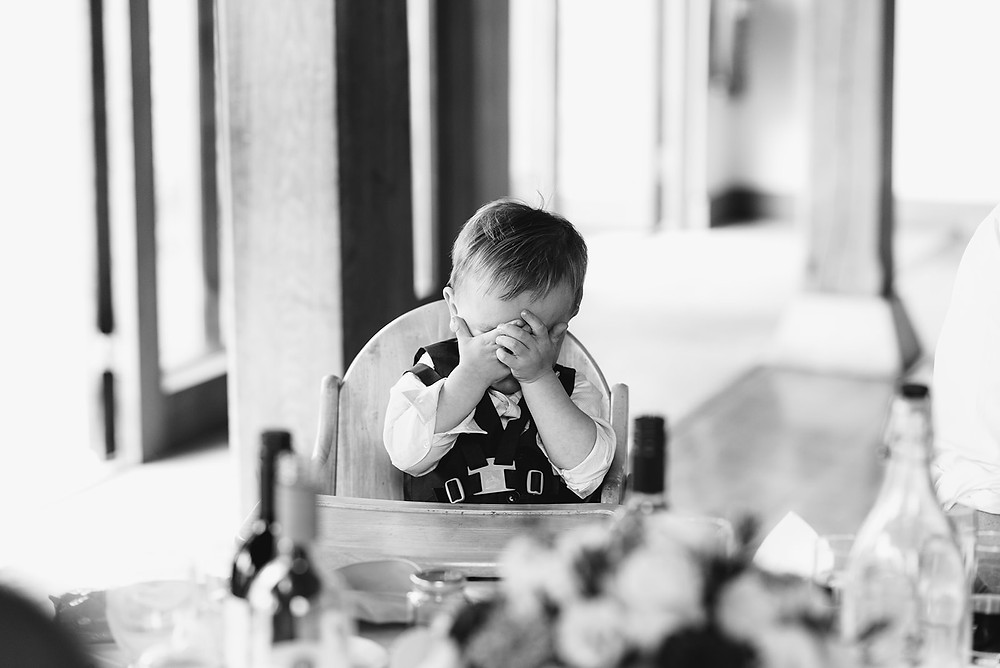 baby at wedding hands over eyes