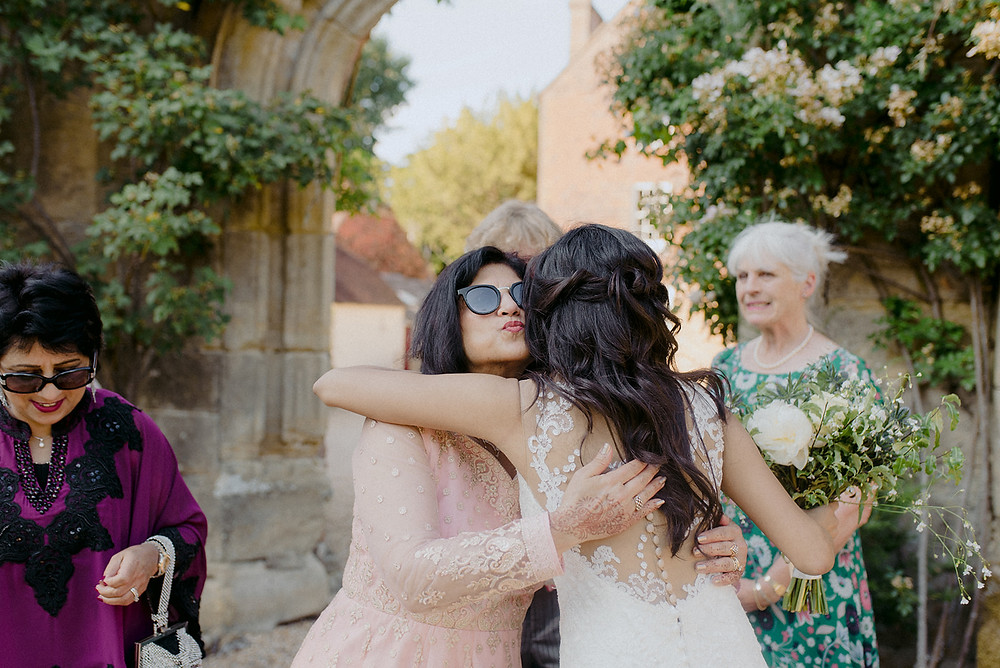 bride hugging wedding guests documentary photography