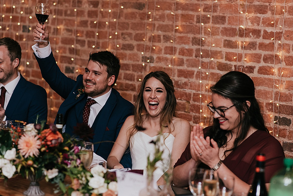 raising a toast wedding