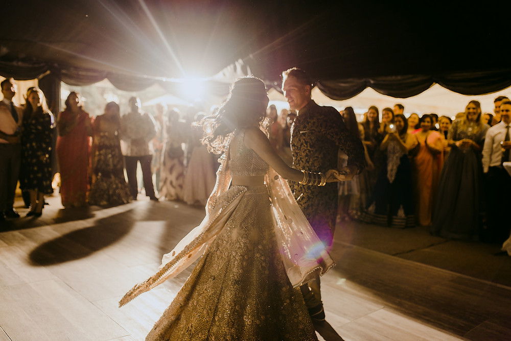 bride and groom first dance light flare