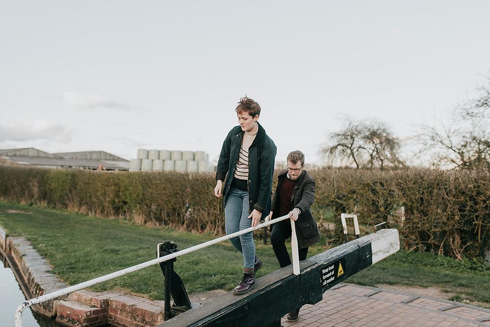 locks on canal couple walking