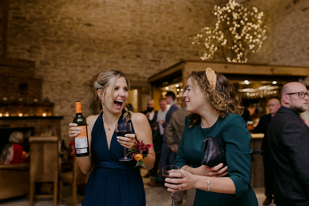 guests drinking wine at a wedding