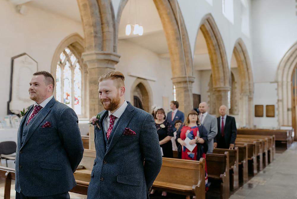 groom and best man waiting for bride in church