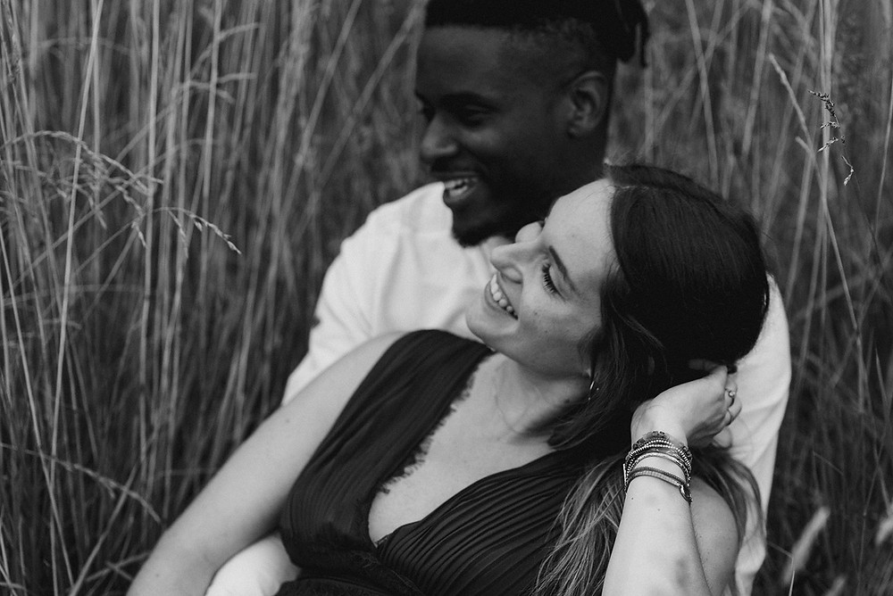 close up black and white photo of couple in field