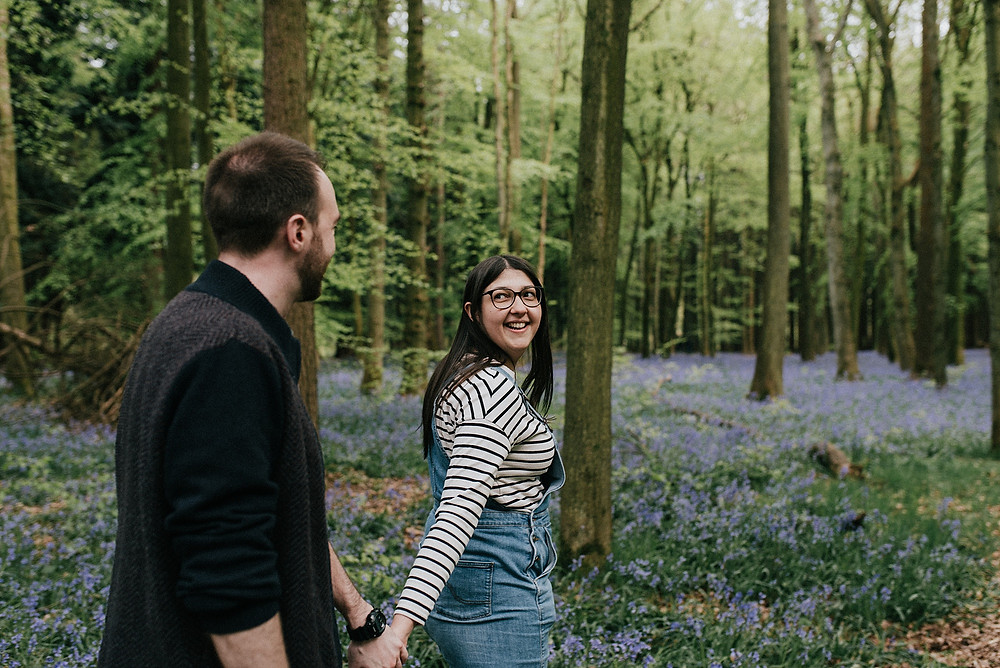 couple exploring bluebell wood