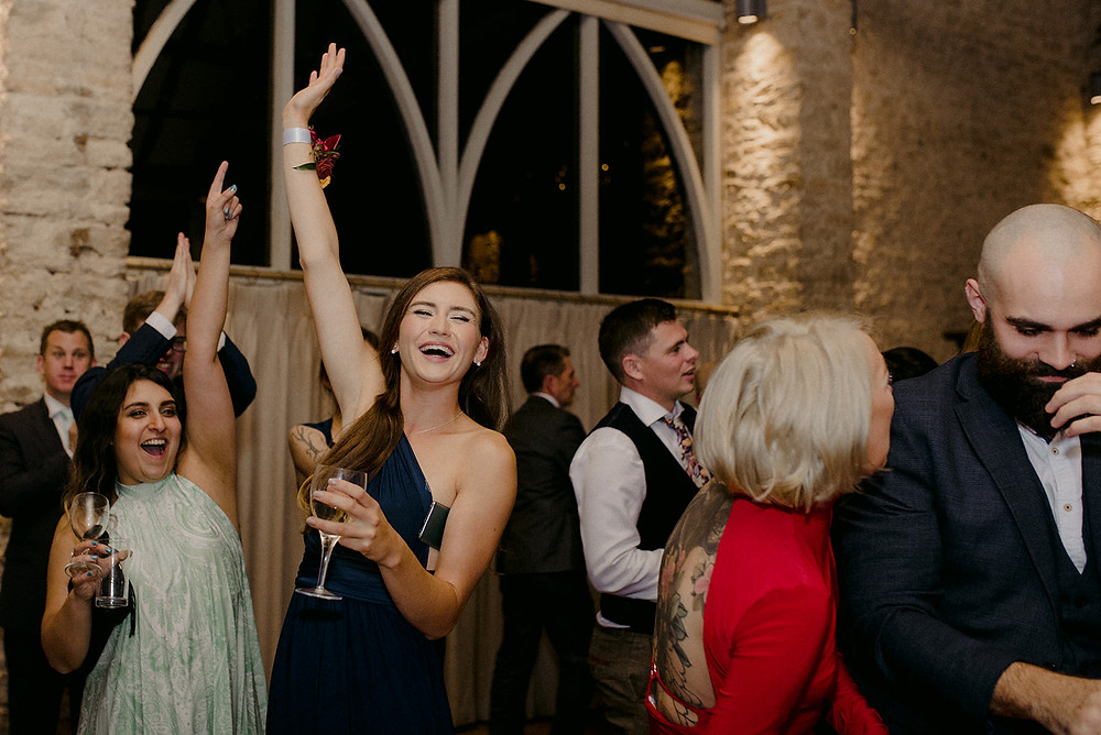 guests having fun on the dance floor at a wedding