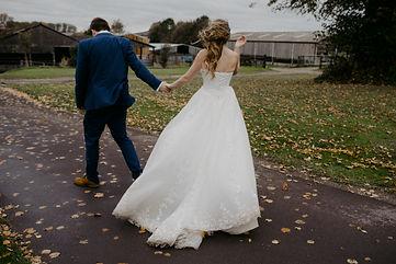 outdoor wedding photographer couple walking