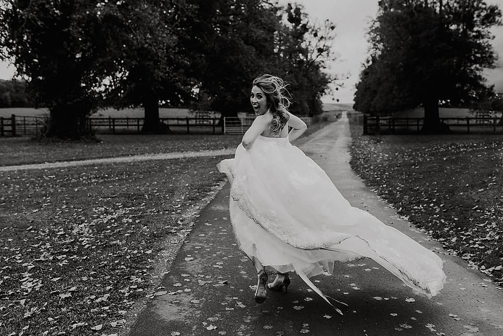 bride running in windswept dress