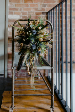 alternative bouquet with feathers and thistles