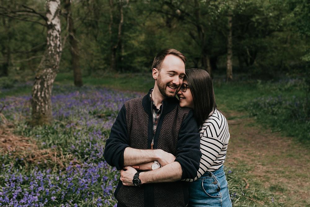 couple cutting bluebell woodland