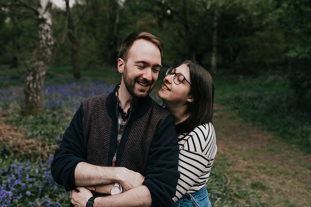 engaged couple in bluebells