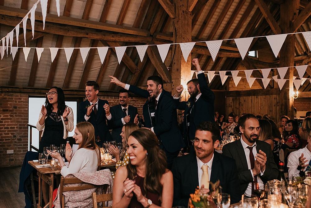 guests cheering at wedding
