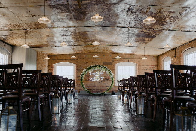 industrial wedding with neon sign