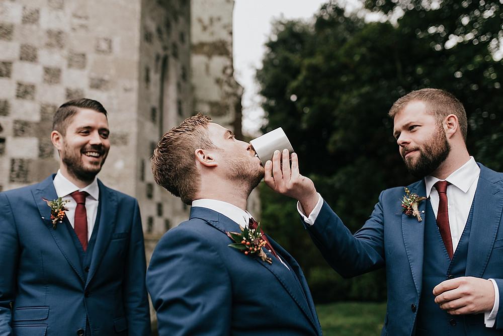 groomsmen drinking whisky hip flask