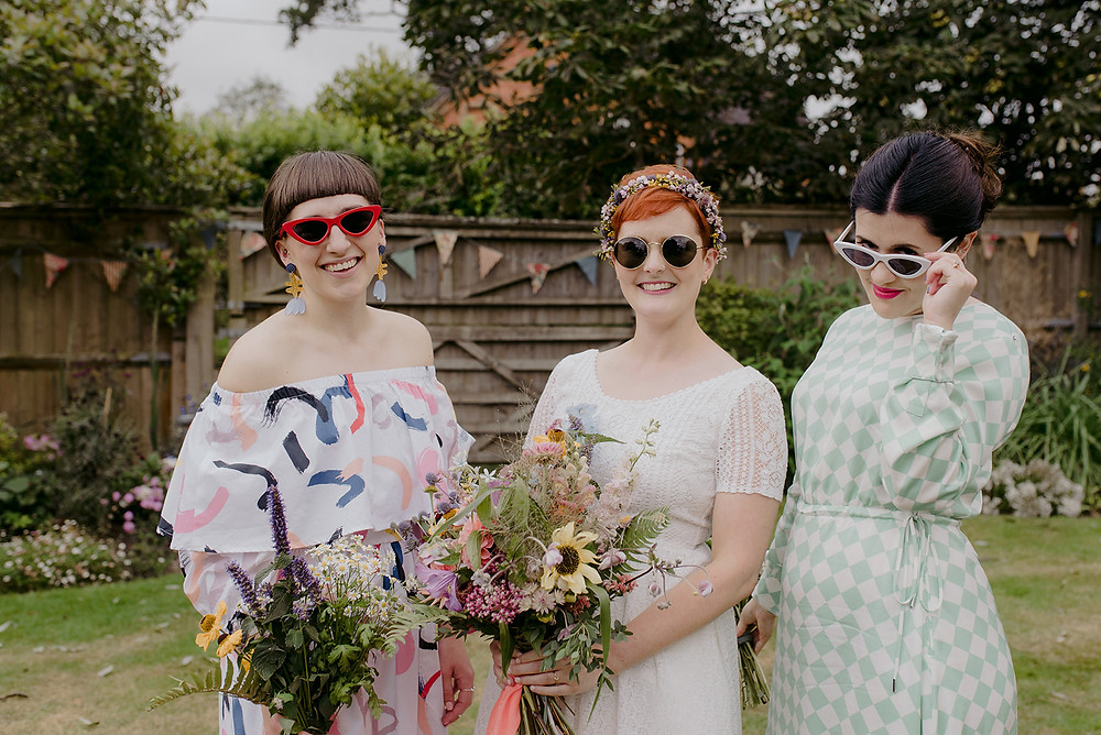 cool bride and bridesmaids at garden wedding