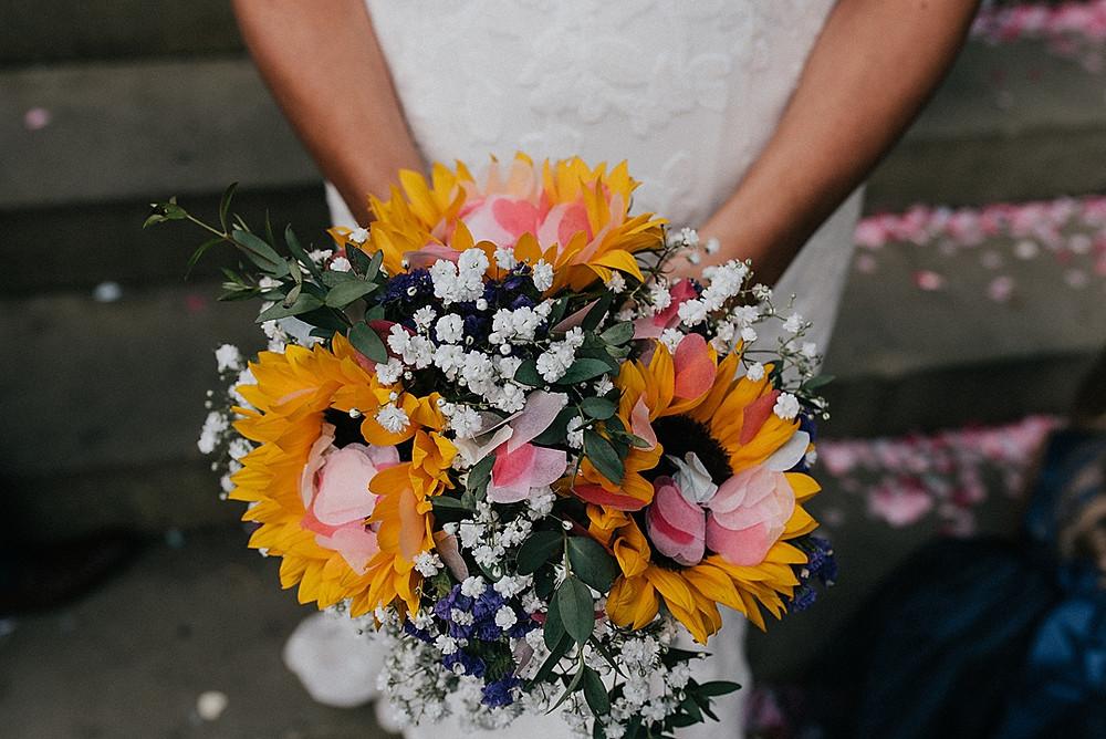 sunflower bouquet and confetti