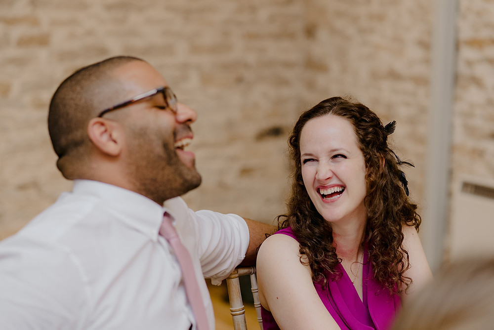 guests laughing at grooms wedding speech