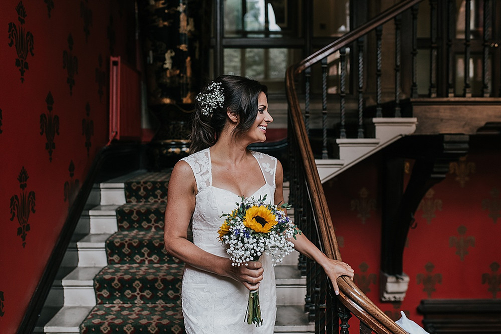 bride on stairs with sunflowers