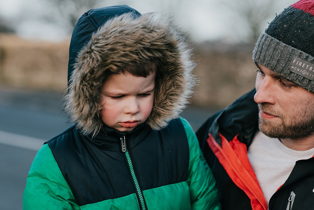 boy with father in winter