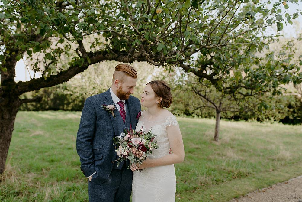 wedding couple under apple tree