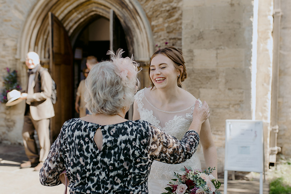 guests greeting bride after ceremony
