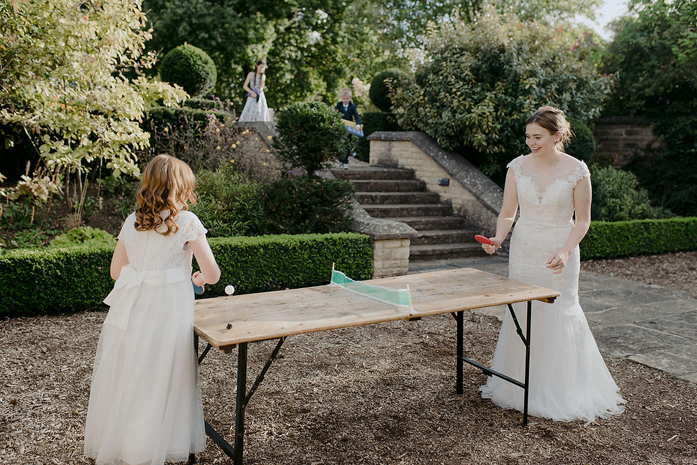 bride and flower girl playing table tennis