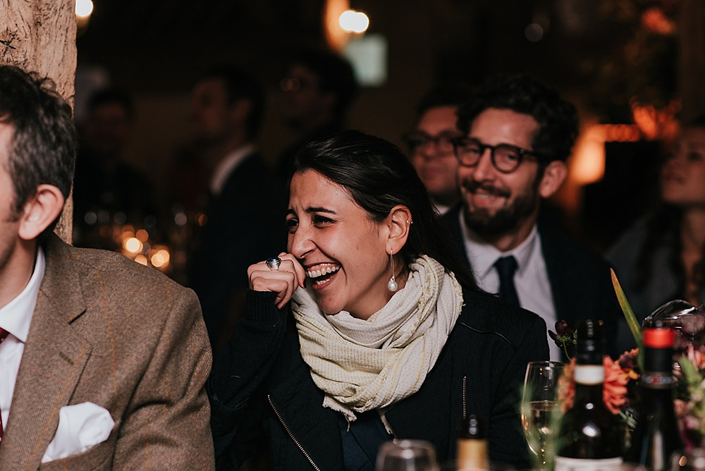 guest laughing at speeches at wedding