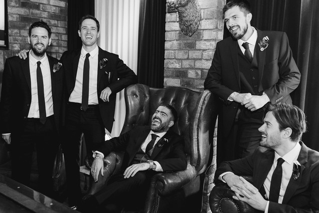 black and white photo of groomsmen and groom