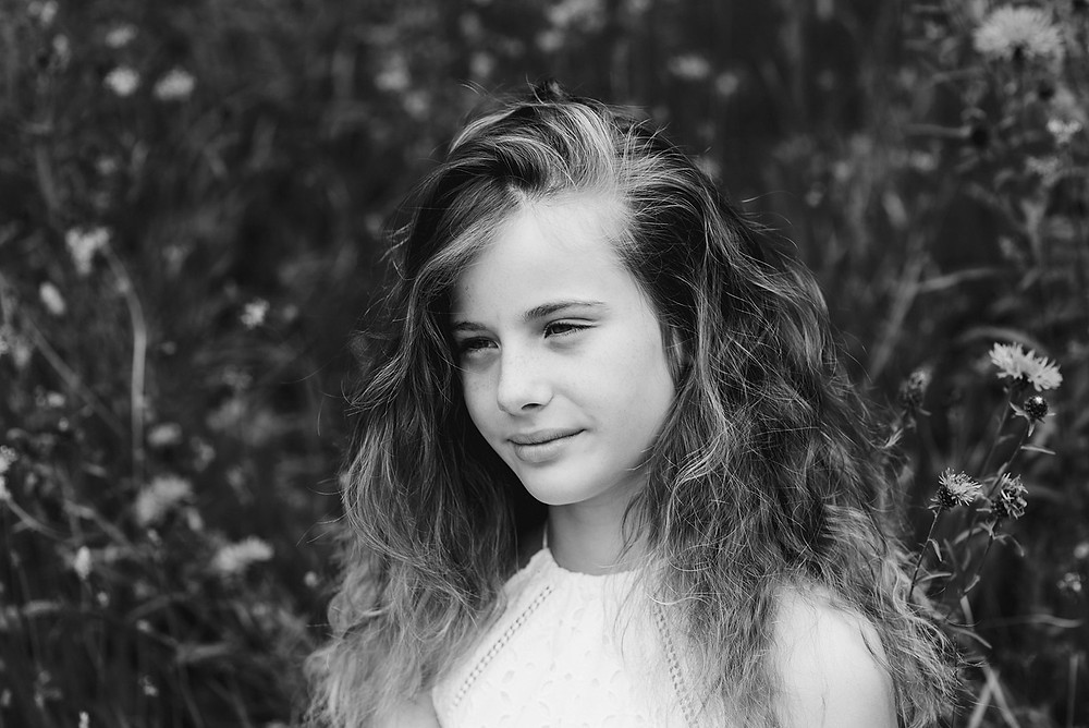black and white portrait of girl on family photoshoot